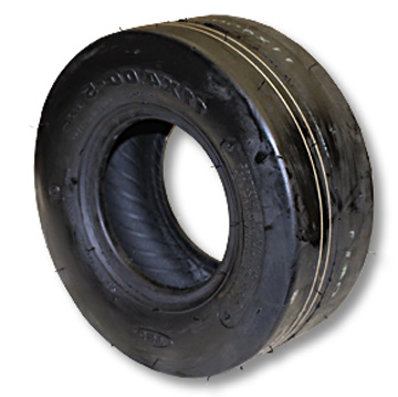 "Part No. 7006, Slick Tire, 11-400 x 5, 4 Ply, 4"" Wide, 10.8"" OD"